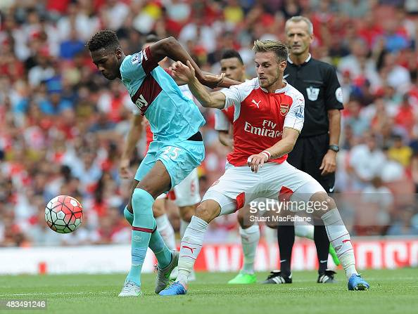 Aaron Ramsey of Arsenal challenges Reece Oxford of West Ham during the Barclays Premier League match between Arsenal and West Ham United at Emirates...