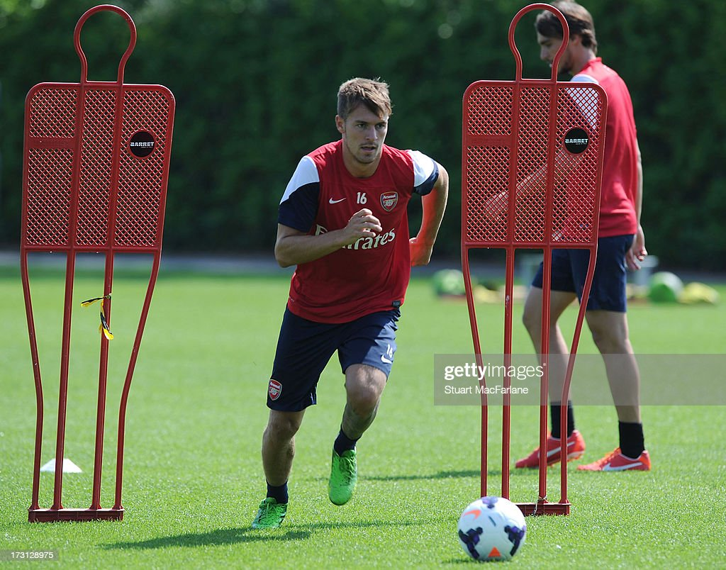 <a gi-track='captionPersonalityLinkClicked' href=/galleries/search?phrase=Aaron+Ramsey+-+Soccer+Player&family=editorial&specificpeople=4784114 ng-click='$event.stopPropagation()'>Aaron Ramsey</a> of Arsenal during a training session at London Colney on July 08, 2013 in St Albans, England.