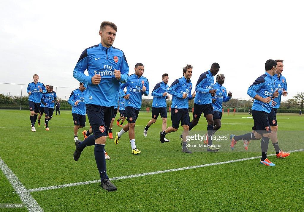 ST. ALBANS, ENGLAND - <a gi-track='captionPersonalityLinkClicked' href=/galleries/search?phrase=Aaron+Ramsey&family=editorial&specificpeople=4784114 ng-click='$event.stopPropagation()'>Aaron Ramsey</a> of Arsenal during a training session at London Colney on April 11, 2014 in St Albans, England.