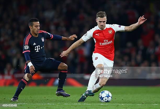 Aaron Ramsey of Arsenal evades Thiago Alcantara of Bayern Munich during the UEFA Champions League Group F match between Arsenal FC and FC Bayern...