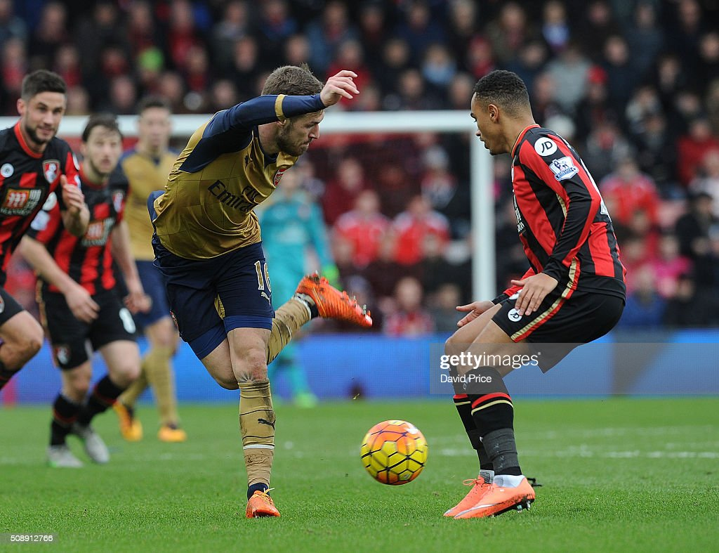 <a gi-track='captionPersonalityLinkClicked' href=/galleries/search?phrase=Aaron+Ramsey&family=editorial&specificpeople=4784114 ng-click='$event.stopPropagation()'>Aaron Ramsey</a> of Arsenal flicks the ball past Junior Stanislas of Bournemouth during the Barclays Premier League match between AFC Bournemouth and Arsenal at The Vitality Stadium, Bournemouth 7th February 2016.