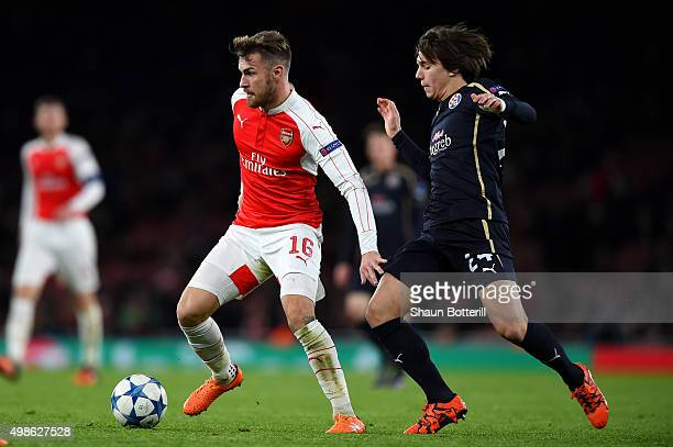 Aaron Ramsey of Arsenal holds off Ante Coric of Dinamo Zagreb during the UEFA Champions League match between Arsenal FC and GNK Dinamo Zagreb at...