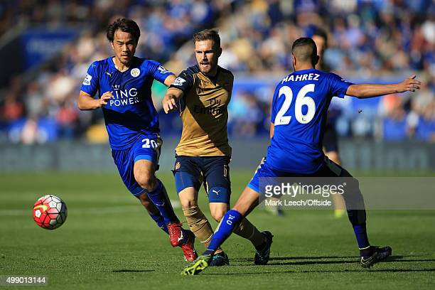 Aaron Ramsey of Arsenal in action with Shinji Okazaki and Riyad Mahrez of Leicester City during the Barclays Premier League match between Leicester...