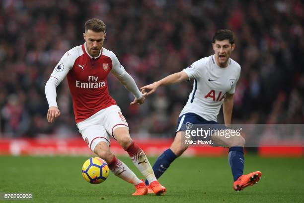 Aaron Ramsey of Arsenal is challenged by Ben Davies of Tottenham during the Premier League match between Arsenal and Tottenham Hotspur at Emirates...