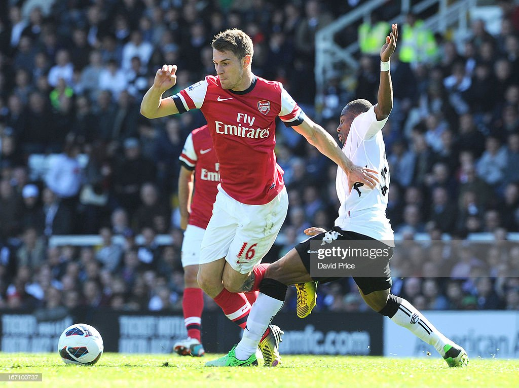 <a gi-track='captionPersonalityLinkClicked' href=/galleries/search?phrase=Aaron+Ramsey&family=editorial&specificpeople=4784114 ng-click='$event.stopPropagation()'>Aaron Ramsey</a> of Arsenal is challenged by <a gi-track='captionPersonalityLinkClicked' href=/galleries/search?phrase=Eyong+Enoh&family=editorial&specificpeople=4134782 ng-click='$event.stopPropagation()'>Eyong Enoh</a> of Fulham during the Barclays Premier League match between Fulham and Arsenal at Craven Cottage on April 20, 2013 in London, England.