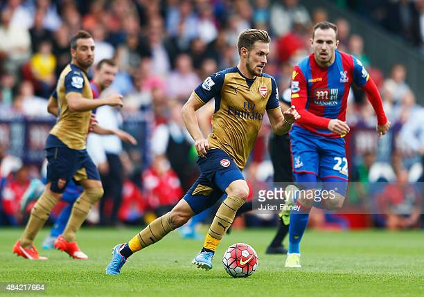 Aaron Ramsey of Arsenal is closed down by Jordon Mutch of Crystal Palace during the Barclays Premier League match between Crystal Palace and Arsenal...