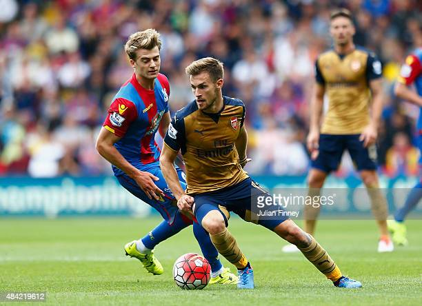 Aaron Ramsey of Arsenal is closed down by Patrick Bamford of Crystal Palace during the Barclays Premier League match between Crystal Palace and...
