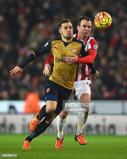 Aaron Ramsey of Arsenal is held by Glenn Whelan of Stoke City during the Barclays Premier League match between Stoke City and Arsenal at Britannia...