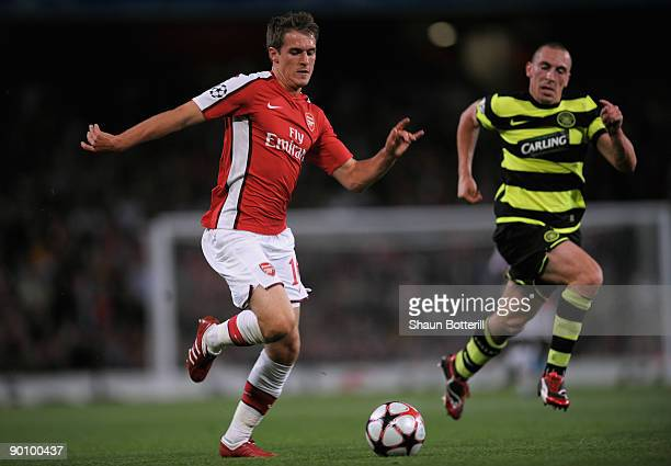 Aaron Ramsey of Arsenal is pursued by Scott Brown of Celtic during the UEFA Champions League 2nd qualifying round 2nd leg match between Arsenal and...