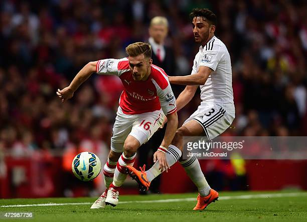 Aaron Ramsey of Arsenal is tackled by Neil Taylor of Swansea City during the Barclays Premier League match between Arsenal and Swansea City at...