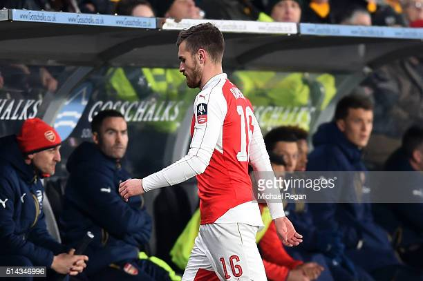 Aaron Ramsey of Arsenal leaves the field during the Emirates FA Cup Fifth Round Replay match between Hull City and Arsenal at KC Stadium on March 8...