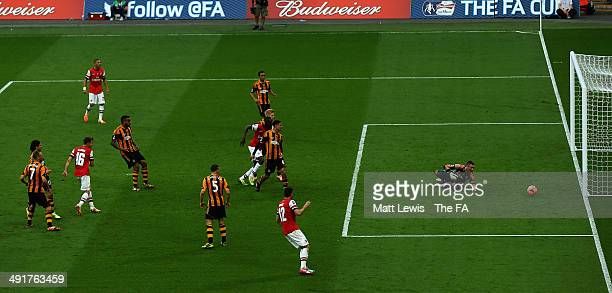 Aaron Ramsey of Arsenal looks on as he scores his teams third goal during the FA Cup Final sponsored by Budweiser between Arsenal and Hull City at...