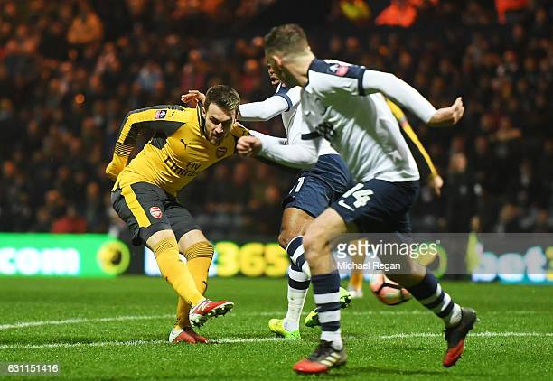 Aaron Ramsey of Arsenal scores a goal to level the scores at 11 during the Emirates FA Cup Third Round match between Preston North End and Arsenal at...