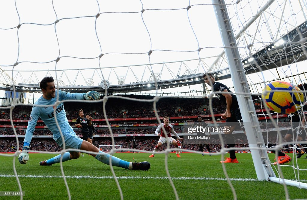 Aaron Ramsey of Arsenal scores his sides second goal past Lukasz Fabianski of Swansea City during the Premier League match between Arsenal and Swansea City at Emirates Stadium on October 28, 2017 in London, England.