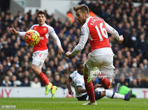 Aaron Ramsey of Arsenal scores his team's first goal during the Barclays Premier League match between Tottenham Hotspur and Arsenal at White Hart...