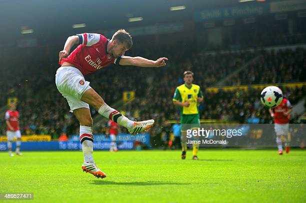 Aaron Ramsey of Arsenal scores the opening goal during the Barclays Premier League match between Norwich City and Arsenal at Carrow Road on May 11...