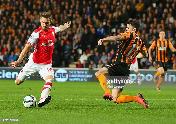 Aaron Ramsey of Arsenal scores their second goal as Robbie Brady of Hull City attempts to block during the Barclays Premier League match between Hull...