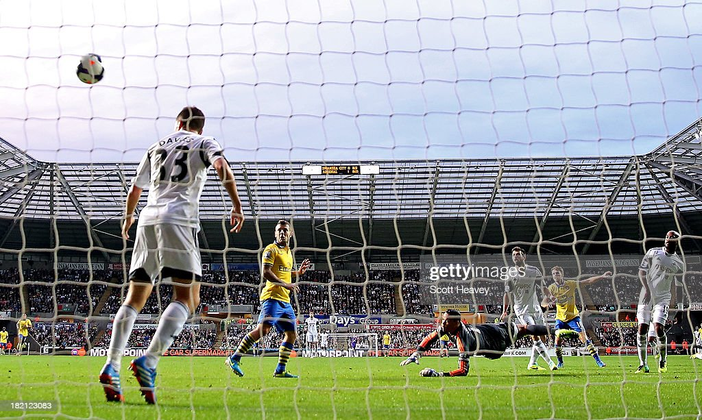 <a gi-track='captionPersonalityLinkClicked' href=/galleries/search?phrase=Aaron+Ramsey&family=editorial&specificpeople=4784114 ng-click='$event.stopPropagation()'>Aaron Ramsey</a> of Arsenal scores their second goal during the Barclays Premier League match between Swansea City and Arsenal at Liberty Stadium on September 28, 2013 in Swansea, Wales.