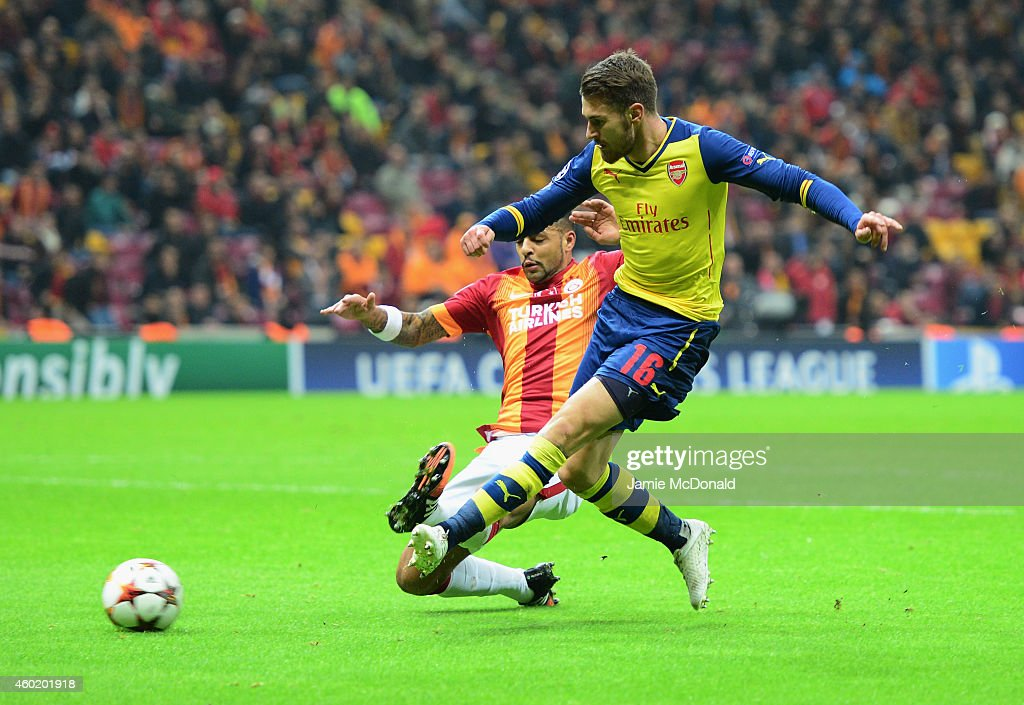 Aaron Ramsey of Arsenal (R) scores their second goal during the UEFA Champions League Group D match between Galatasaray AS and Arsenal FC at Ali Sami Yen Arena on December 9, 2014 in Istanbul, Turkey.
