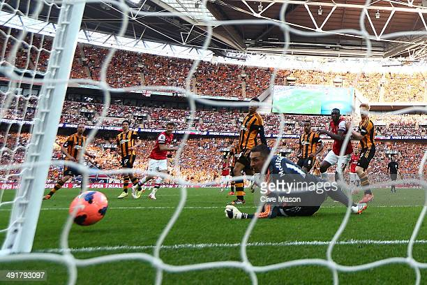 Aaron Ramsey of Arsenal shoots past Allan McGregor of Hull City to score their third goal during the FA Cup with Budweiser Final match between...