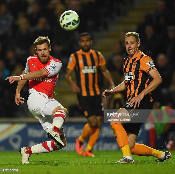 Aaron Ramsey of Arsenal shoots past Michael Dawson of Hull City during the Barclays Premier League match between Hull City and Arsenal at KC Stadium...
