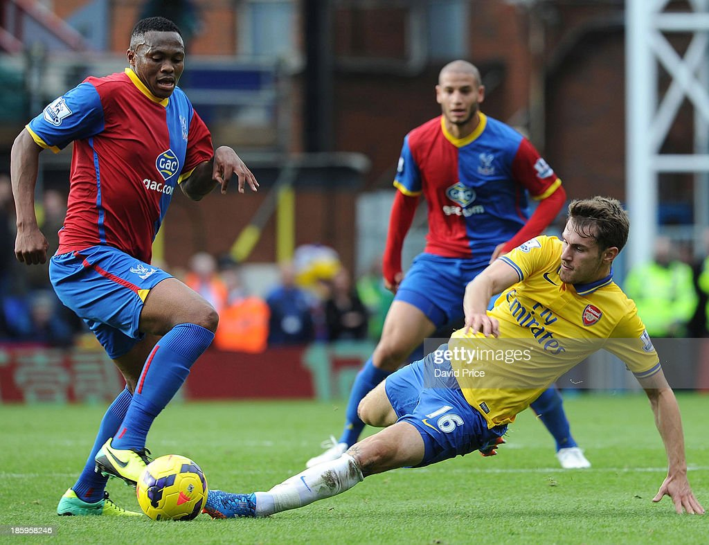 Aaron Ramsey of Arsenal tackles Kagisho Dikgacoi of Palace during the match between Crystal Palace and Arsenal at Selhurst Park on October 26, 2013 in London, England.