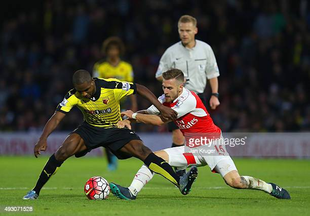 Aaron Ramsey of Arsenal tackles Odion Ighalo of Watford during the Barclays Premier League match between Watford and Arsenal at Vicarage Road on...