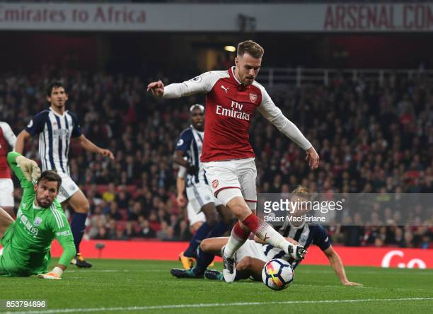 Aaron Ramsey of Arsenal takes on Ben Foster of WBA during the Premier League match between Arsenal and West Bromwich Albion at Emirates Stadium on...