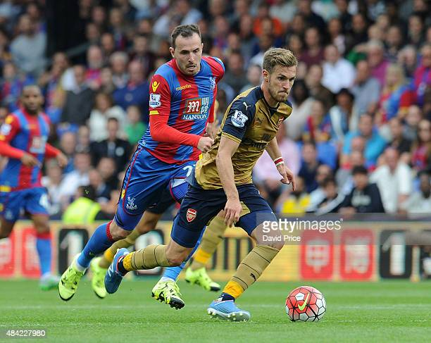 Aaron Ramsey of Arsenal takes on Jordan Mutch of Crystal Palace during the Barclays Premier League match between Crystal Palace and Arsenal on August...
