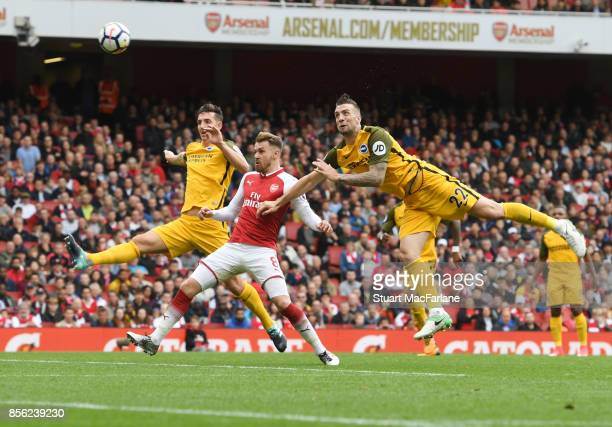 Aaron Ramsey of Arsenal takes on Lewis Dunk and Shane Duffy of Brighton during the Premier League match between Arsenal and Brighton and Hove Albion...