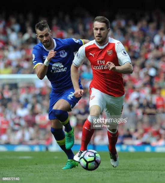Aaron Ramsey of Arsenal takes on Morgan Schneiderlin of Everton during the Premier League match between Arsenal and Everton at Emirates Stadium on...