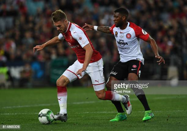 Aaron Ramsey of Arsenal takes on Roly Bonevacia of Western Wanderers during the match between the Western Sydney Wanderers and Arsenal FC at ANZ...