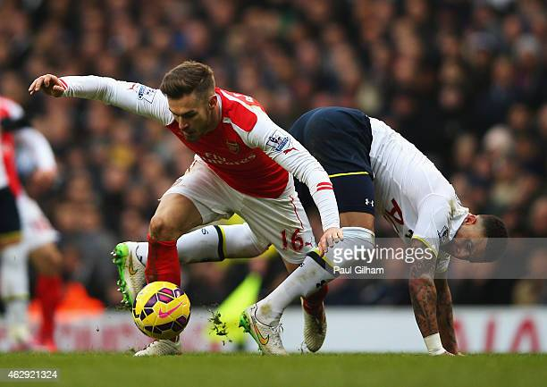 Aaron Ramsey of Arsenal tangles with Kyle Walker of Tottenham Hotspur during the Barclays Premier League match between Tottenham Hotspur and Arsenal...