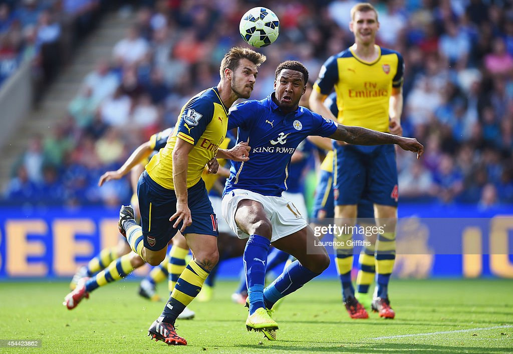 Aaron Ramsey of Arsenal wins the ball from Liam Moore of Leicester City during the Barclays Premier League match between Leicester City and Arsenal at The King Power Stadium on August 31, 2014 in Leicester, England.