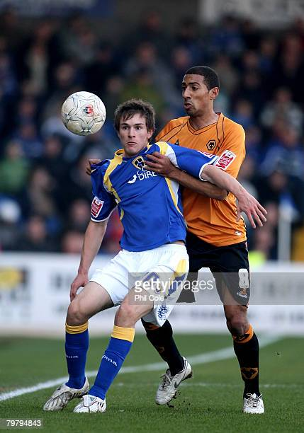 Aaron Ramsey of Cardiff City clears the ball from Karl Henry of Wolverhampton Wanderers during the FA Cup Fifth Round match sponsored by Eon between...