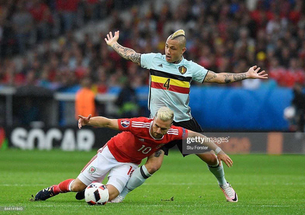 Aaron Ramsey of Wales and Radja Nainggolan of Belgium compete for the ball during the UEFA EURO 2016 quarter final match between Wales and Belgium at Stade Pierre-Mauroy on July 1, 2016 in Lille, France.