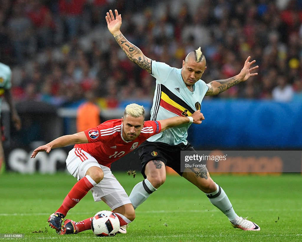 <a gi-track='captionPersonalityLinkClicked' href=/galleries/search?phrase=Aaron+Ramsey+-+Soccer+Player&family=editorial&specificpeople=4784114 ng-click='$event.stopPropagation()'>Aaron Ramsey</a> of Wales and <a gi-track='captionPersonalityLinkClicked' href=/galleries/search?phrase=Radja+Nainggolan&family=editorial&specificpeople=6339191 ng-click='$event.stopPropagation()'>Radja Nainggolan</a> of Belgium compete for the ball during the UEFA EURO 2016 quarter final match between Wales and Belgium at Stade Pierre-Mauroy on July 1, 2016 in Lille, France.