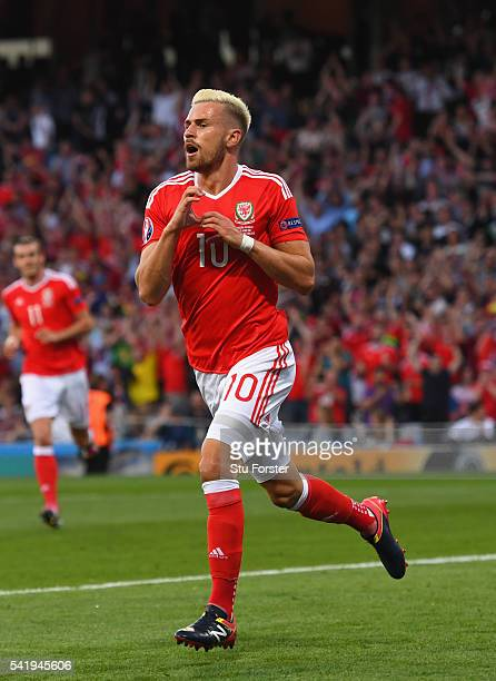 Aaron Ramsey of Wales celebrates after scoring his goal during the UEFA EURO 2016 Group B match between Russia and Wales at Stadium Municipal on June...
