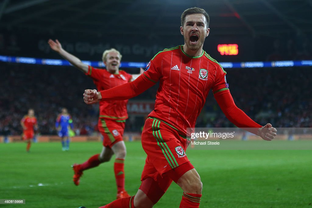 Aaron Ramsey of Wales celebrates scoring the opening goal during the UEFA EURO 2016 Qualifier match at the Cardiff City Stadium on October 13 2015 in...