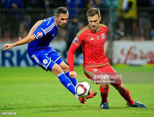 Aaron Ramsey of Wales in action against Anel Hadzic of Bosnia during the Euro 2016 qualifying football match between Bosnia and Herzegovina and Wales...