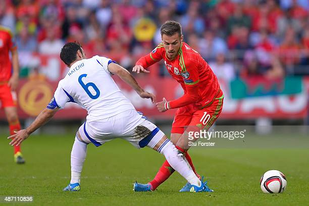 Aaron Ramsey of Wales is tackled by Bibras Natkho of Israel during the UEFA EURO 2016 group B qualifying match between Wales and Israel at Cardiff...