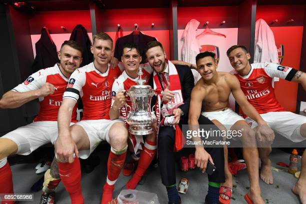 Aaron Ramsey Per Mertesacker Granit Xhaka Shkodran Mustafi Alexis Sanchez and Mesut Ozil celebrate after the Emirates FA Cup Final between Arsenal...
