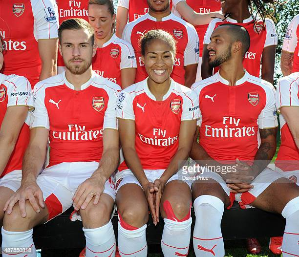 Aaron Ramsey Rachel Yankey of Arsenal Ladies and Theo Walcott during the Arsenal 1st Team Group Photograph at London Colney on September 10 2015 in...