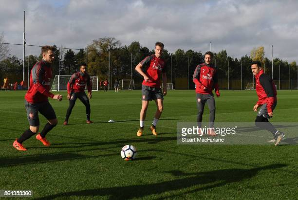 Aaron Ramsey Rob Holding Mesut Ozil and Alexis Sanchez of Arsenal during a training session at London Colney on October 21 2017 in St Albans England