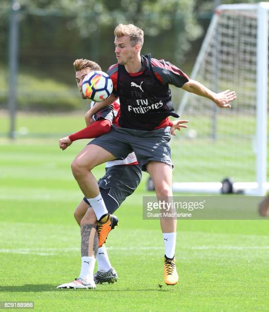 Aaron Ramsey Rob Holding of Arsenal during a training session at London Colney on August 10 2017 in St Albans England