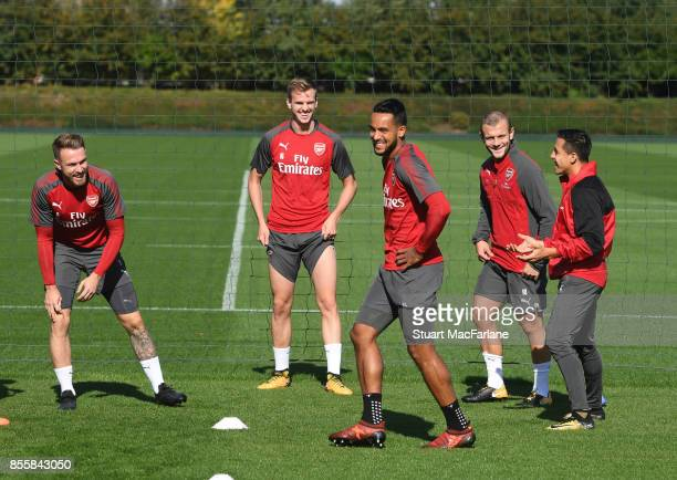 Aaron Ramsey Rob Holding Theo Walcott Jack Wilshere and Alexis Sanchez of Arsenal during a training session at London Colney on September 30 2017 in...
