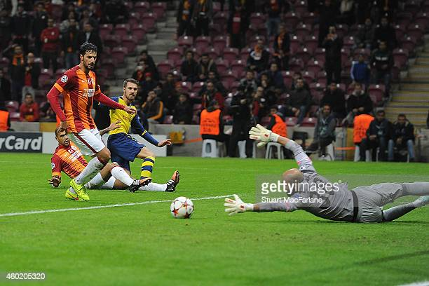 Aaron Ramsey shoots past Galatasarary goalkeeper Sinan Bolat to score the 2nd Arsenal goal during the UEFA Champions League match between Galatasaray...