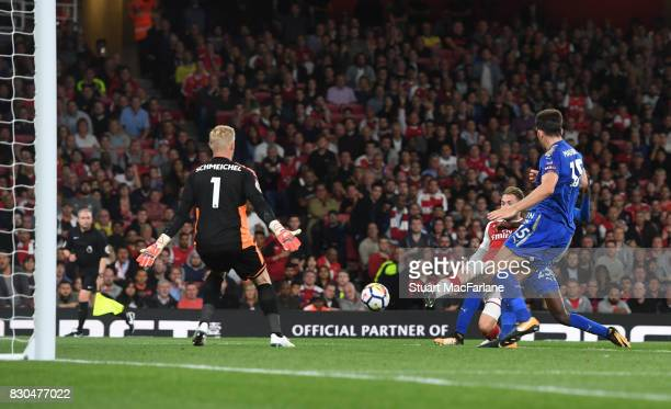 Aaron Ramsey shoots past Leicester goalkeeoer Kasper Schmeichel to score th 3rd Arsenal goal during the Premier League match between Arsenal and...