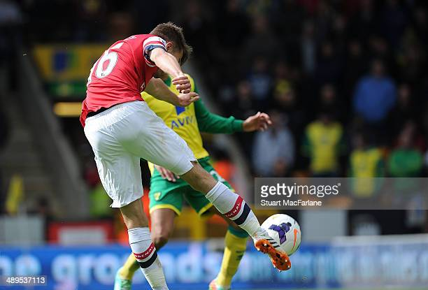 Aaron Ramsey shoots past Norwich goalkeeper John Ruddy to score the 1st Arsenal goal during the Barclays Premier League match between Norwich City...