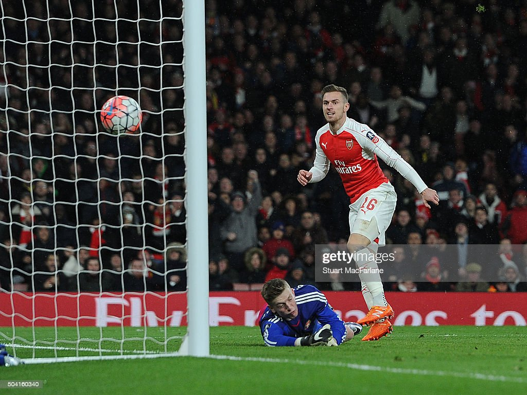 Aaron Ramsey shoots past Sunderland goalkeeper Jordan Pickford to score the 2nd Arsenal goal during the Emirates FA Cup Third Round match between Arsenal and Sunderland at Emirates Stadium on January 9, 2016 in London, England.